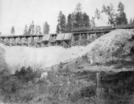 Filling Four Mile Creek trestle, mile 127.2 : Blasting some rocks on the cars