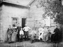 Group of pioneers outside of homestead