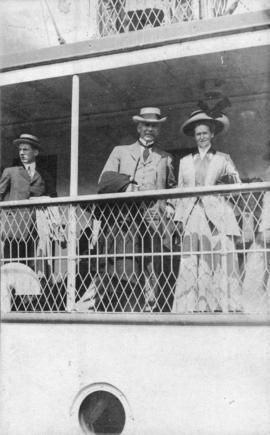 R.P. Grayham and wife [at railing on passenger ship]