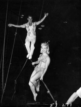 Man and woman performing in high wire act in P.N.E. Shrine Circus