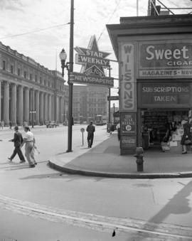 [Granville Street at Cordova showing Wilson's Newspapers, the Kelly Douglas Ltd. building an...