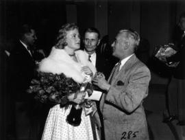 C. Defieux and unidentified man speaking with Glenda Sjoberg, winner of Miss P.N.E. 1955