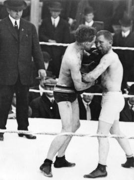 [A boxing match between Roy Campbell and Dick Hyland]