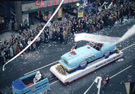 43rd Grey Cup Parade, on Granville Street, Esso float, ticker tape, and spectators