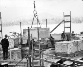 Stuart Cameron and Company workmen placing granite facings of South piers.  Huge blocks were cut ...