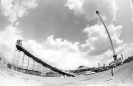 View of slide, amusement rides, and Space Tower in P.N.E. Playland