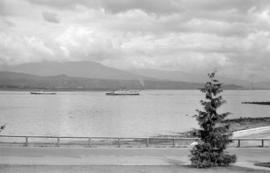 [View from Stanley Park of two Union Steamship vessels leaving harbour]