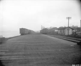 [Freight tracks, cars and sheds for the Great Northern Railway at the south side of False Creek]