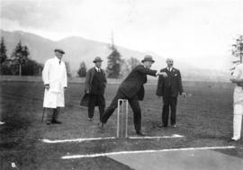 [Mayor L.D. Taylor bowling the first ball at opening of cricket season, Brockton Point Oval]