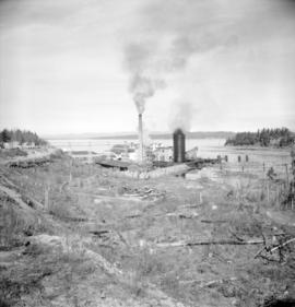 [View of the H.R. McMillan Co. logging and lumbering operation looking towards the water]