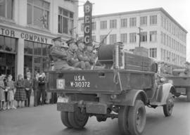 [A military vehicle in a parade on Georgia Street]