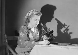 National War Finance, Shirley McKay with stethoscope [microscope], West Vancouver