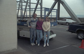 Group posing on Burrard Bridge during restoration