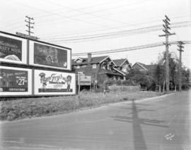 [Billboards and houses on 16th Avenue at West Boulevard]