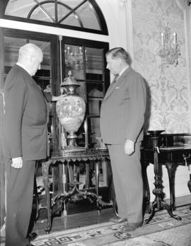 Honourable Ian McKenzie and General McRae [inspecting an urn at Hycroft]