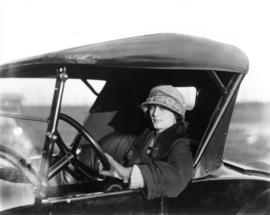 Miss Dorothy Thompson [at wheel of car]