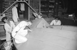 [Workers assembling a PBY airplane at the Boeing plant on Sea Island]