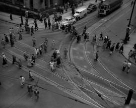 [View of pedestrians crossing at the intersection of Hastings and Granville Streets taken from ab...