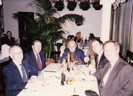 George Ogg, Tony Alderson, Hugh Pickett, Gordon Boyd and unidentified man having dinner at a rest...