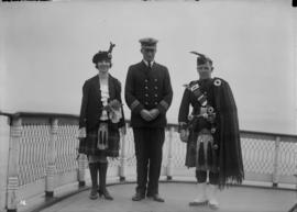 B.C.S.R. 8th annual picnic [two Highland dancers with a man in uniform]