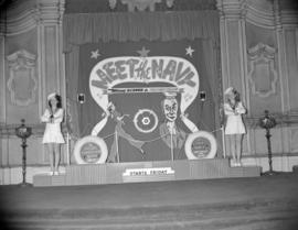 "[Women in sailor suits in front of a ""Meet the Navy"" movie display in the Orpheum Theatre]"