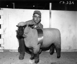 Man with award-winning sheep in 1959 P.N.E. Livestock competition