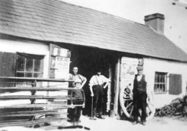 "[Exterior of the blacksmith's shop at ""The Toy""]"