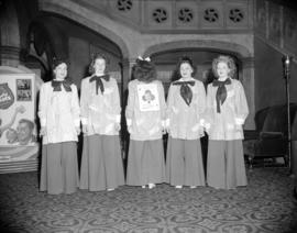 "[Group portrait of Orpheum Theatre staff wearing costumes to promote the movie ""Lady Luck&qu..."