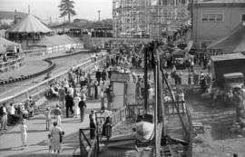 [View of rides at the Pacific National Exhibition midway at Hastings Park]