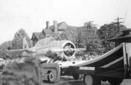[Aircraft being towed in P.N.E. parade]