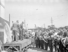 Presentation of [Victory] flags [at Granville Island]