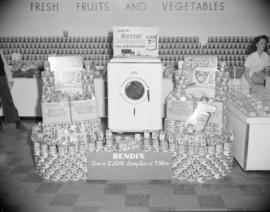 [Burns' canned meat and Bendix washing machine display in a grocery store]