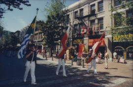 Fire Department Band members marching with flags