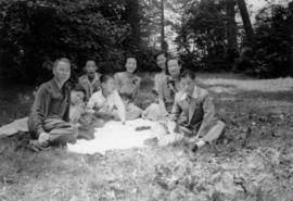 Gum May Yee, Lillian Ho Wong, Mrs. Chan, Guy Yee, Mrs. Chan's three sons, and an unidentified man...
