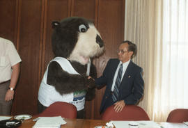 Tillicum shaking hands with a Centennial Committee member at Vancouver City Hall