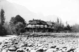 [Unidentified hotel or large residence on river bank - fishing lodge]