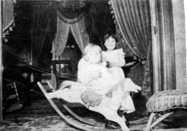 [Two unidentified children with a rocking horse]
