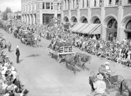 [Carriages and Carts carrying pioneers in the Calgary Stampede parade]