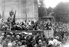 [Samuel Hill and R.H. Gale and others on stage at Peace Arch dedication]