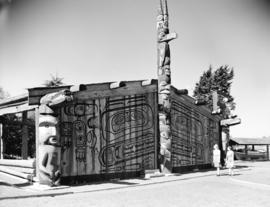 [Shelter and totem poles in] Thunderbird Park [Victoria, B.C.]