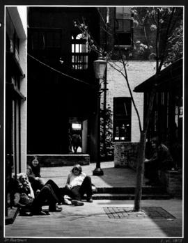 [Group of people relaxing in the sun] in Gastown