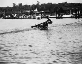 Indian canoe log jumping, Coal Harbour
