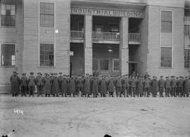 [Group of soldiers in front of the Industrial Building]