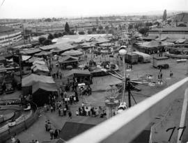 View of amusement rides and tents in P.N.E. Gayway