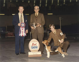 Best in Show award being presented at 1975 P.N.E. All-Breed Dog Show [Beagle]