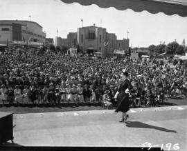 Fashion show and crowd at Outdoor Theatre stage