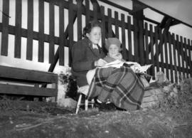 [Two girls waiting to see King George VI and Queen Elizabeth]