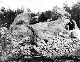 [Men breaking apart] conglomerate boulder - on Vachon's property - 56th Ave.