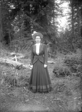 Ethel in woods opposite house [in Cedar Cottage]