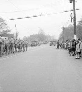 [Soldiers and vehicles in a parade along Burrard Street]